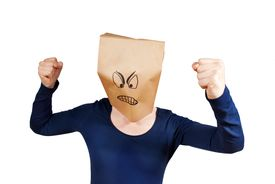 picture of angry smiley  - a person with an angry paper bag smiley on its head isolated - JPG