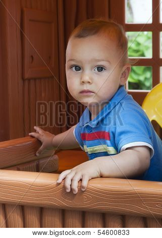 Child in playhouse
