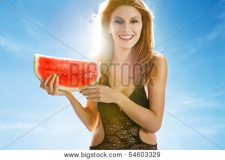 Woman with a slice of watermelon