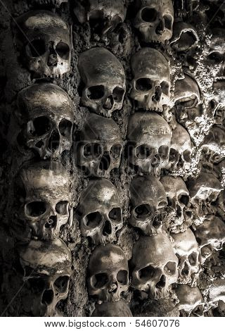 Wall full of skulls and bones in the bone chapel in Evora, Portugalhe bone chapel in Evora, Portugal
