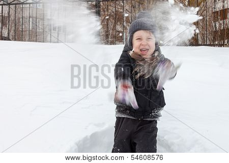 Boy Plays In The Snow