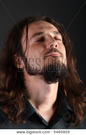Portrait Of A Guy Caught In The Middle Of Sincere Prayer With His Eyes Closed