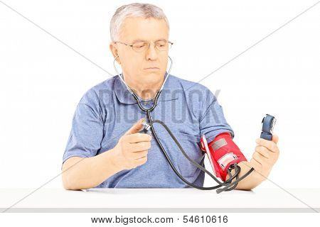 Senior man measuring blood pressure with sphygmomanometer isolated on white background