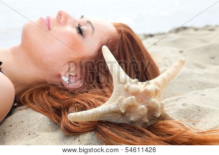 The Beautiful Girl Lies On Sea Coast With Shells Nature Vacation