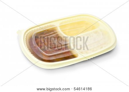 Sole with creole sauce and mashed potatoes in a closed package to go or to freeze. Package on white background.
