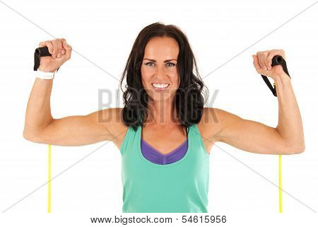 Female Fitness Model Flexing Muscles With Stretch Bands