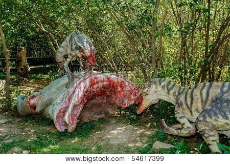 Model Of Two Raptors Eating Pray