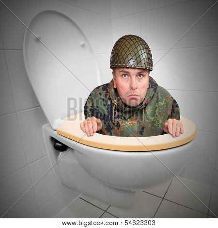 Cowardly soldier hiding in the toilet bowl. Funny picture from army.