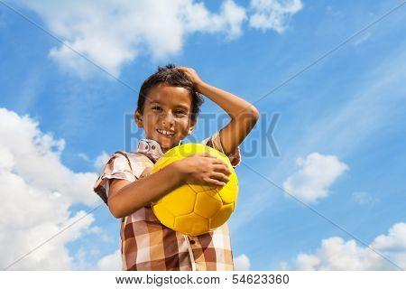 Boy With Ball Over Sky