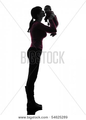 one caucasian woman holding kissing baby silhouette on white background