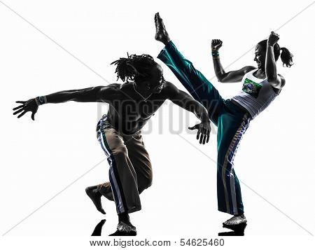 two people couple capoiera dancers dancing in silhouette studio isolated on white background