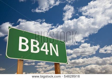 BB4N, Texting Abbreviation for Bye Bye For Now, Green Road Sign with Dramatic Sky and Clouds.