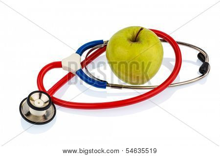 an apple and a stethoscope on a doctor. symbolic photo for healthy and vitamin-rich diet.