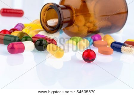 many tablets container. lying on a white background