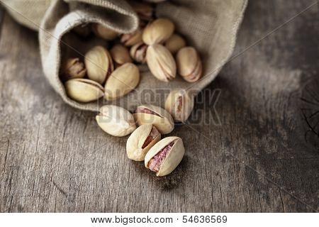 Roasted And Salted Pistachios Pour Out Of The Bag