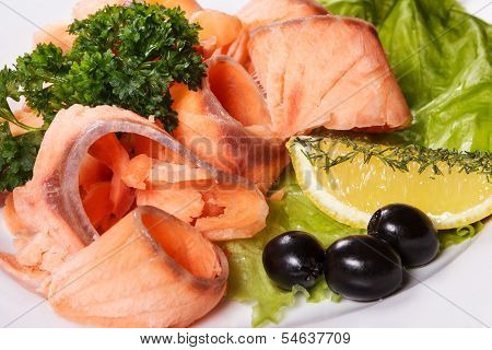 Slices Of Tasty Fish With Spices On Dish