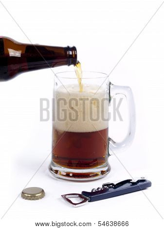 Pouring Dark Bock Beer From The Bottle Into The Glass