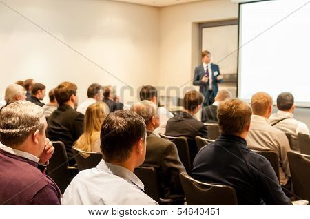 People Sitting At The Business Conference And Speaker At The Screen poster