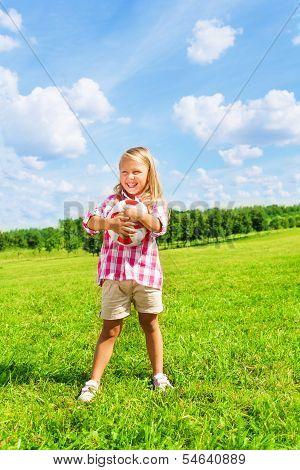 Little Girl Holding Football Ball