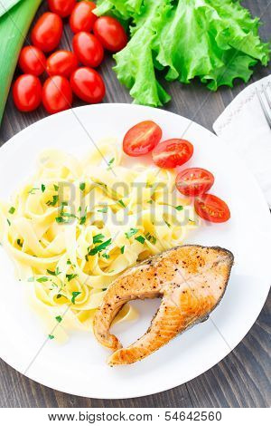 Delicious fettuccini with fried salmon