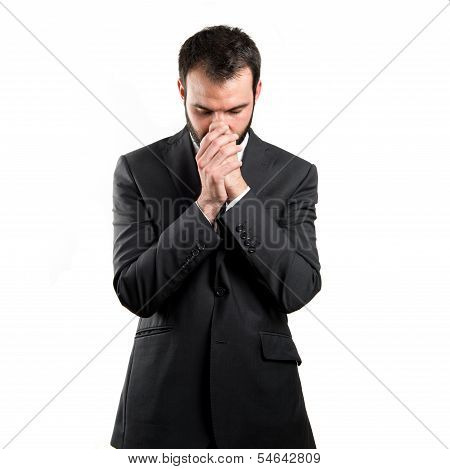 Young Businessman Pleading Over White Background