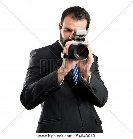 Young Businessman Recording Video Over White Background