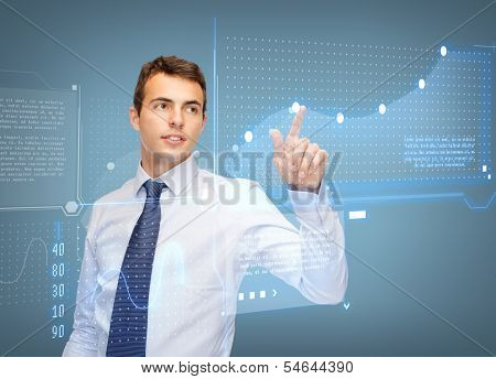 business, new technology and communication concept - businessman working with virtual screen and graphs on it