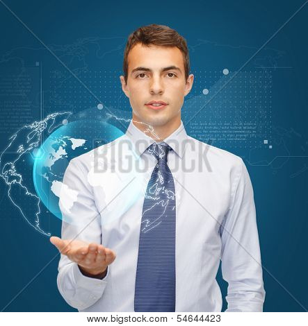 business, office and new technology concept - friendly young buisnessman holding virtual sphere globe on the palm of his hand