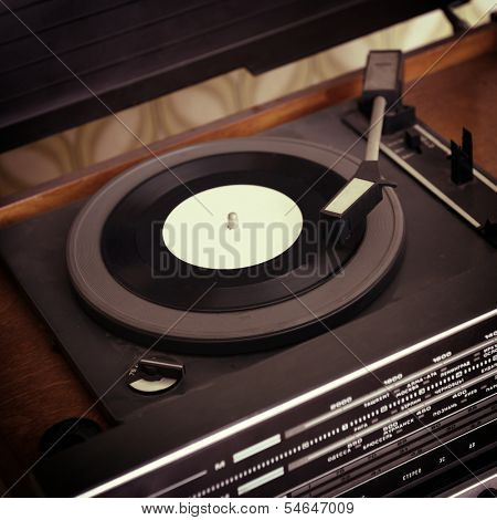 Retro record player, detail shot, toned