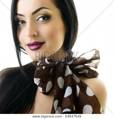 Young attractive woman with bow of neck-piece and nice makeup looking at camera, studio shot of pretty girl over white
