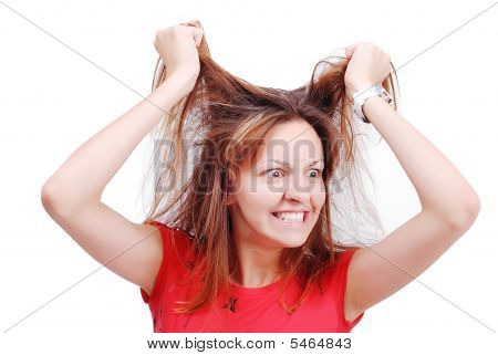 Young Female Model Grabbing Her Hair With Angry Expression On Face