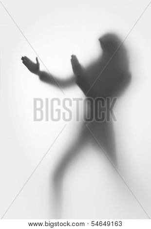 Woman silhouette protects herself