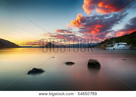 Krk bridge at dusk with colorful sunset, Croatia