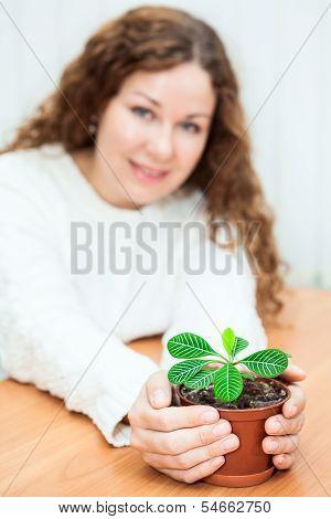 Woman with flowerpot