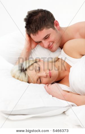 Boy Looking At Her Girlfriend Sleeping