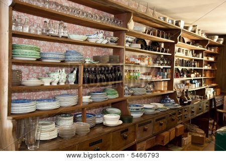 Vintage Dry Goods Store With Glassware On Display