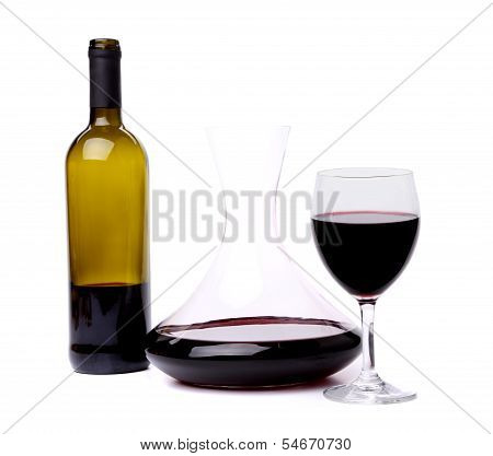 glass and bottle of red wine decanter