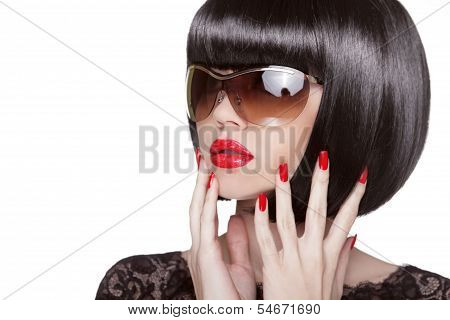 Fashion Portrait Of Brunette Woman In Sunglasses Showing Red Manicured Polish Nails. Professional Ma