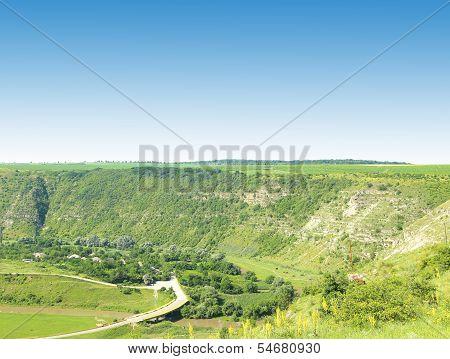 River channel extending along a steep bank