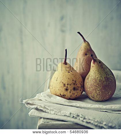 Still life with autumn pears on linen