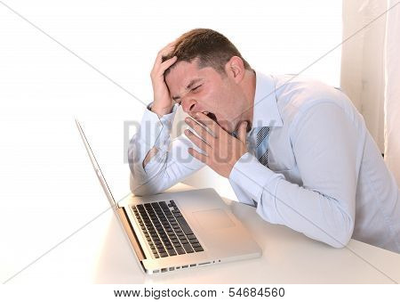 Stressed  Overworked Businessman Sleeping Over Keyboard