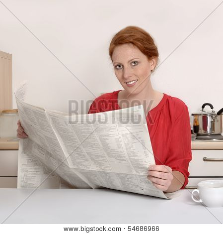 Pretty Red Haired Woman Reading Newspaper