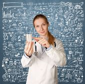 stock photo of sperm  - Doctor woman with cup for analysis - JPG
