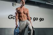 foto of six pack  - Strong Bodybuilder Training His Six Pack - JPG