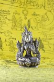 stock photo of tantric  - The statuette of a dharmapala diety on a yellow background - JPG