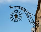 Medieval  Iron Shop Sign In Shape Of Lantern And Star poster