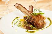 foto of scallion  - Roasted sheep meat with bones on dish  in restaurant - JPG