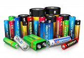stock photo of cylinder  - Group of different size color batteries isolated on white background with reflection effect - JPG