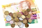 picture of copper coins  - scattered coins on three South African Rand bank notes - JPG
