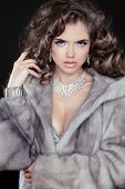 Fashion Winter Woman Model Wearing In Mink Fur Coat With Long Wavy Hair Styling. Jewelry. Luxury Lif